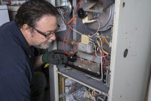 man repairing heater